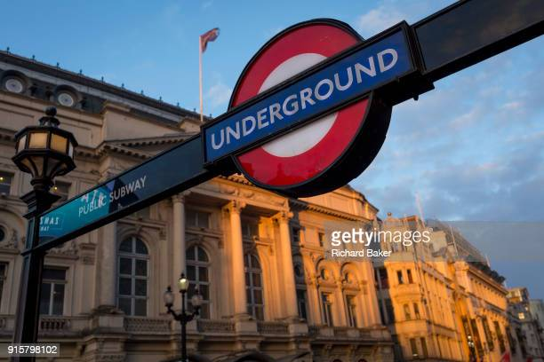 Winter sunshine on a London Underground sign and the Trocadero in Piccadilly Circus on 6th February 2018 in London England