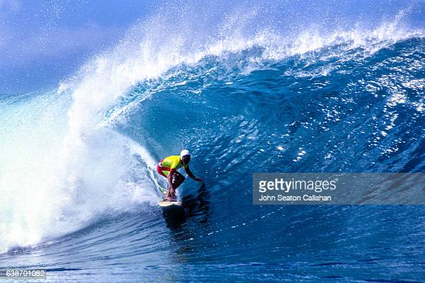 winter surfing at the pipeline - waimea bay hawaii stock photos and pictures