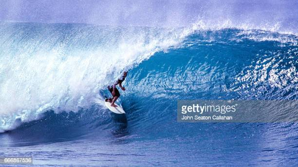winter surfing at the pipeline - banzai pipeline stock photos and pictures