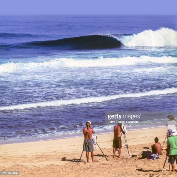 winter surfing on the north shore - haleiwa stock photos and pictures