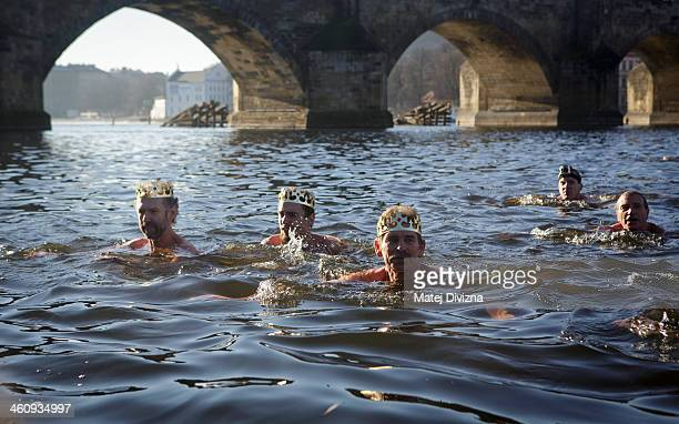 Winter swimmers attend the traditional Three Kings swim in the Moldau river on January 6 2014 in Prague Czech Republic About thirty swimmers took...