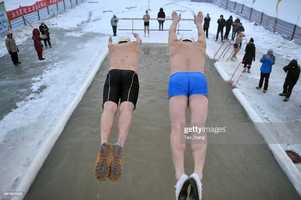 1820a9eae Winter swimmers plunge into SongHua River to mark The upcoming New ...