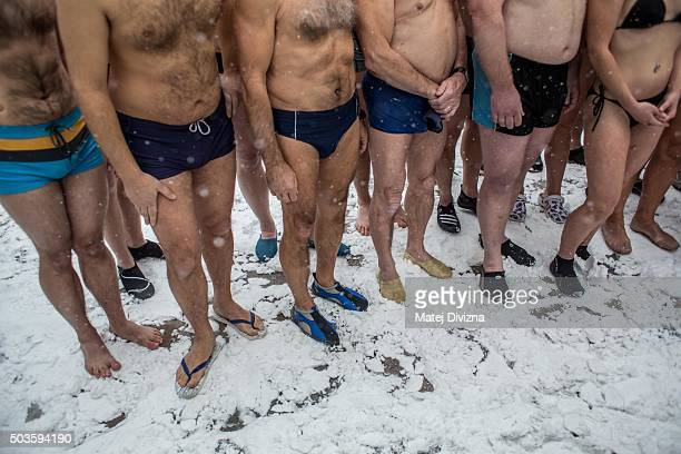 Winter swimmers pose for photographers before the traditional Three Kings swim in the Vltava river on January 6 2016 in Prague Czech Republic About...