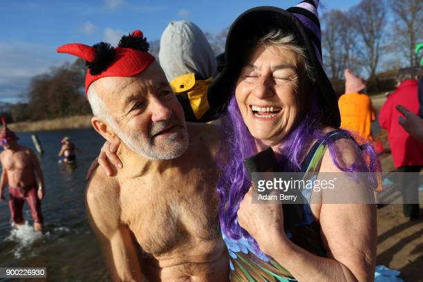 Winter swimmers prepare to bathe in Orankesee lake on January 1 2018 in Berlin Germany Unseasonably higherthanaverage winter temperatures meant no...