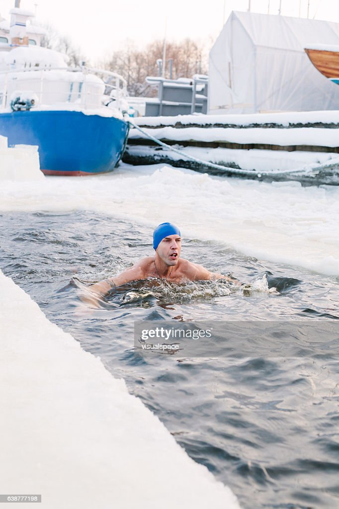 Man swimming in ice cold water.