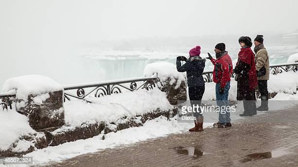 winter tourists at niagara falls - niagara falls photos stock photos and pictures