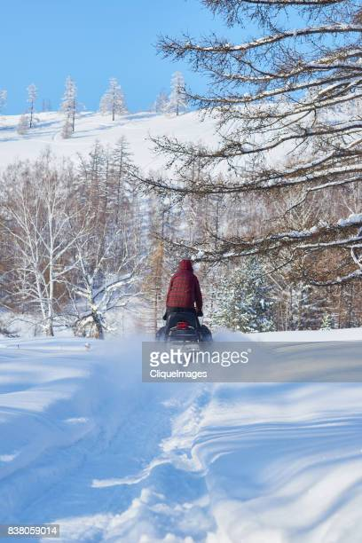 winter travel on snowmobile - cliqueimages stock pictures, royalty-free photos & images
