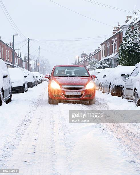winter urban driving in snow at dusk - driving in snow stock photos and pictures