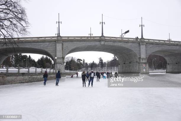 Winter view of Bank Street Bridge of the Rideau Canal Skateway in Ottawa during Winterlude 2019. The world's longest skating rink is enjoyed by many skaters.