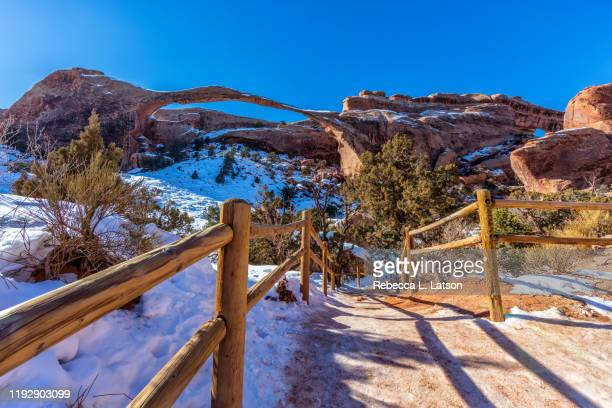 a winter view of landscape arch - january stock pictures, royalty-free photos & images