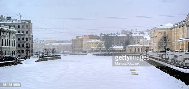 winter view of st petersburg and frozen neva river - neva river stock photos and pictures