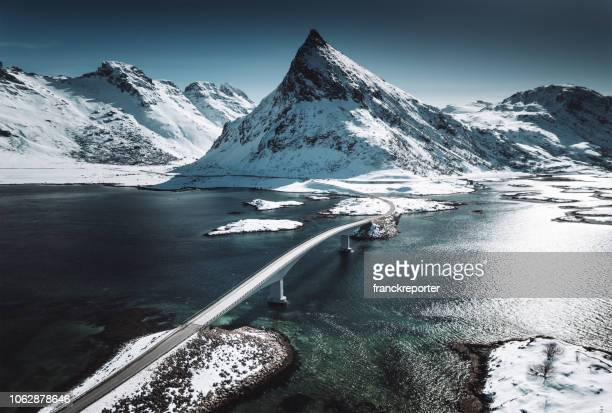 winter view of the bridge at the lofoten islands - atlantic ocean stock pictures, royalty-free photos & images