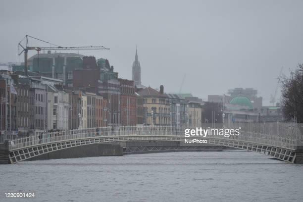 Winter view of the Ha'penny Bridge in Dublin city center during Level 5 Covid-19 lockdown. On Sunday, 31 January in Dublin, Ireland.
