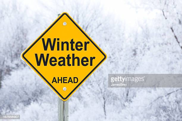 winter weather ahead road sign - winter weather stock photos and pictures