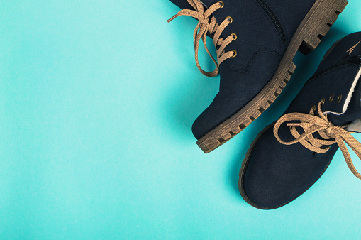 Winter woman boots on a blue background. Winter concept. top view 895853710