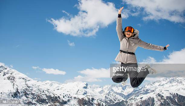 Winter woman jumping