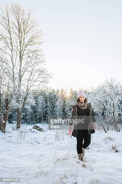 Winter woman outdoors in snowy weather