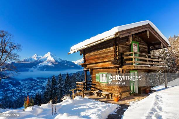 winter wonderland with mountain chalet in the alps - nationalpark berchtesgaden - hut stock pictures, royalty-free photos & images