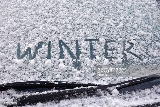 winter written on a snow covered window - winter weather stock pictures, royalty-free photos & images