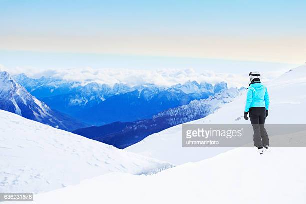 Winter  Young woman snow skier  Alps mountains snowy landscape