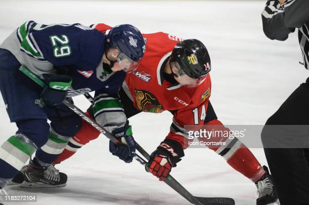Winterhawks center Jake Gracious and Thunderbirds center Jared Davidson face-off during an WHL game between the Seattle Thunderbirds and Portland...