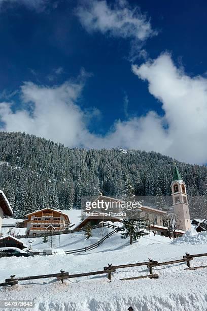winterscape of canazei on italian alps - massimo pizzotti foto e immagini stock