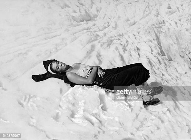 Wintersports skiing Woman taking a sunbath in the snow Picture by Rapho 1936