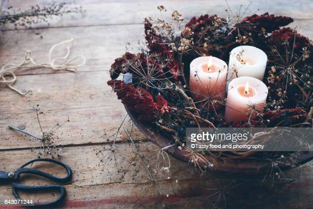 Wintertime decoration with candles and dried plants