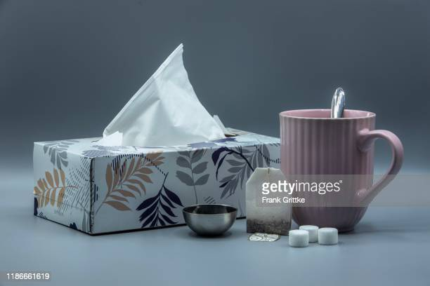 wintertime with a cup of tea and handkerchiefs - handkerchief stock pictures, royalty-free photos & images