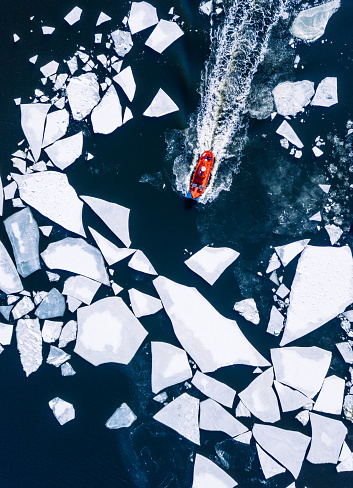 Wintery top-down aerial view of red ice-breaker pushing through cracked ice on Baltic Sea around Helsinki - gettyimageskorea