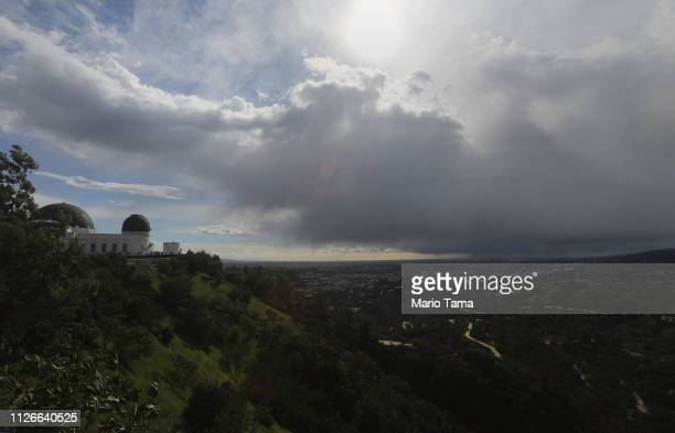 A wintry mix of precipitation falls during an unusually cold winter storm system as seen from near the Griffith Observatory on February 21 2019 in...