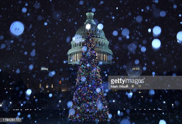 A wintry mix of sleet and snow falls on the US Capitol and its Christmas Tree on December 16 2019 in Washington DC Later this week the full House is...