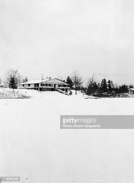 Wintry view of the Idlewild Club House as seen from the frozen surface of Lake Idlewild Idlewild Michigan 1938 Idlewild known as 'the Black Eden' was...