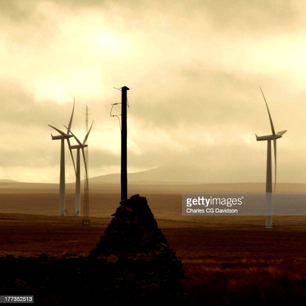 CONTENT] Winturbines in the Scottish Highlands with a roofless cotage and empty telegraph pole Causaymire windfarm Caithness Modern old mountains...