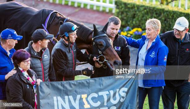 Winx and connections pose for a photo with an Invictus Games banner during a trackwork session at Rosehill Gardens on September 13 2018 in Sydney...