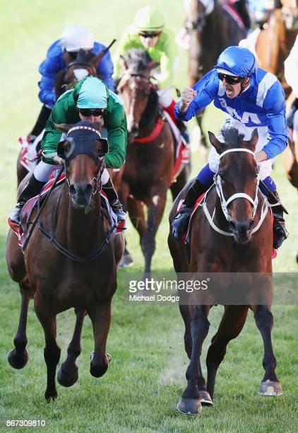 Winx ridden by Hugh Bowman beats Blake Shinn riding Humidor to win race 9 the Ladbrokes Cox Plate during Cox Plate Day at Moonee Valley Racecourse on...