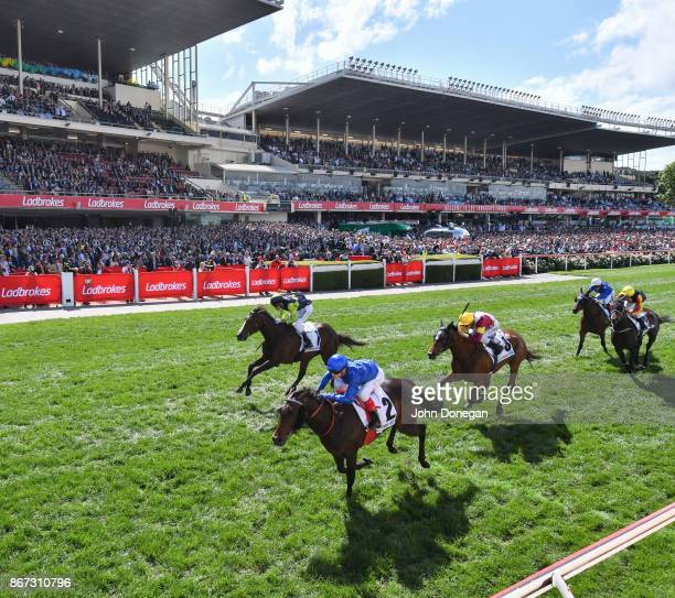 Winx ridden by Hugh Bowman wins the Ladbrokes Cox Plate at Moonee Valley Racecourse on October 28 2017 in Moonee Ponds Australia