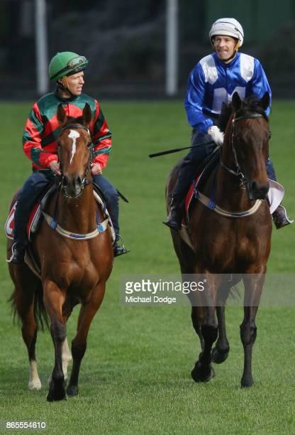 Winx ridden by jockey Hugh Bowman comes off the track with Egg Tart ridden by Kerrin McEvoy during Breakfast With The Stars at Moonee Valley...