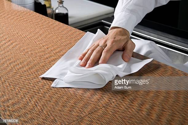 Wiping a kitchen counter