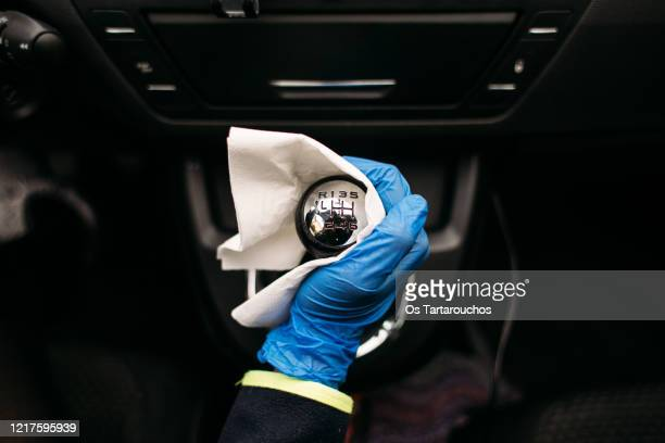 wiping down gear shift lever in a car - clorox bleach stock pictures, royalty-free photos & images