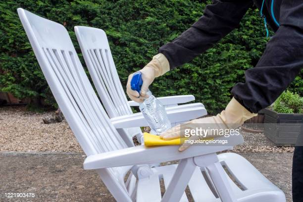 wiping down surfaces - garden chairs - bleach stock pictures, royalty-free photos & images