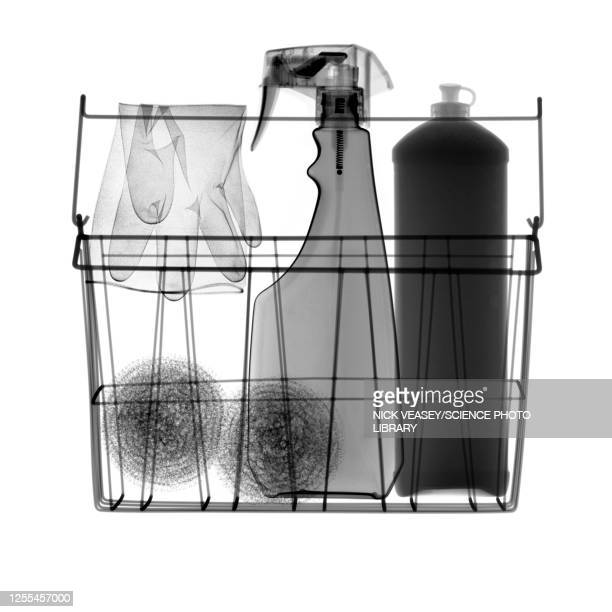 wire basket full of kitchen cleaning equipment, x-ray - washing up glove stock pictures, royalty-free photos & images