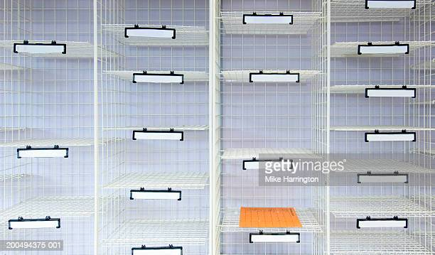 Wire cage storage unit, one pigeon hole with document inside