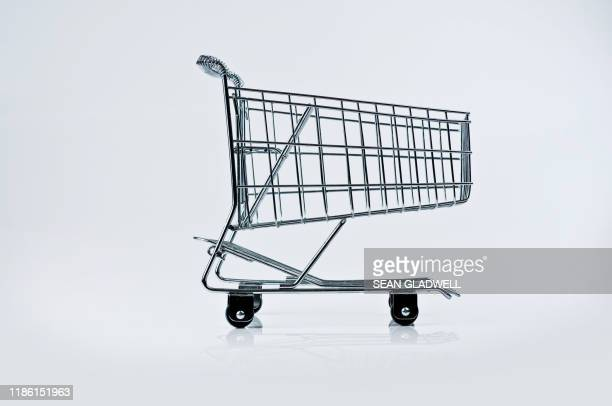 wire frame trolley - shopping trolley stock pictures, royalty-free photos & images