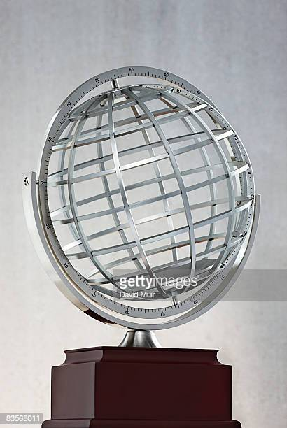 wire globe trophy  - global awards stock pictures, royalty-free photos & images