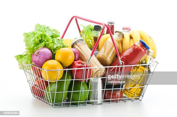wire shopping basket filled with groceries and vegetables - basket stock photos and pictures