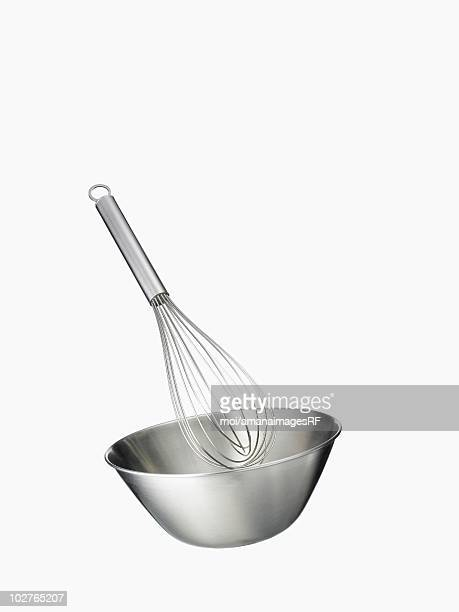 A wire whisk and a bowl