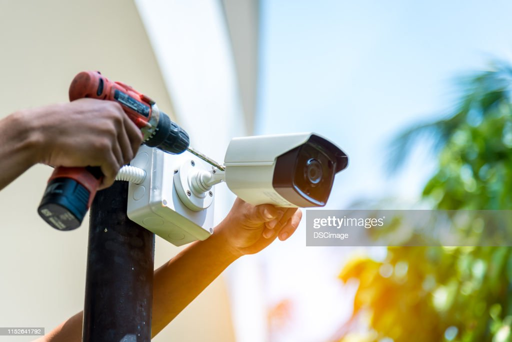 A Wireless CCTV camera setting outside building with white box water poof with sun blur background. : Stock Photo