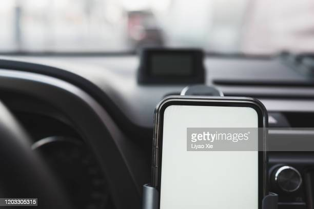wireless charging in car - liyao xie stock pictures, royalty-free photos & images