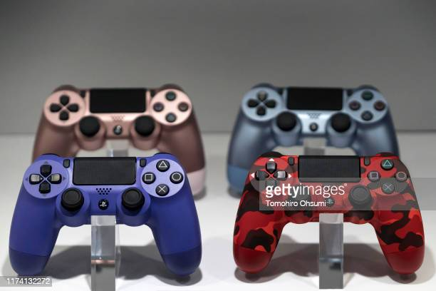 Wireless controllers for the PlayStation 4 game console are displayed in the Sony Interactive Entertainment Inc. Booth on the business day of the...
